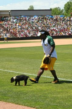Dujuan Harris and his puppy at the Jordy Nelson Charity Softball Game