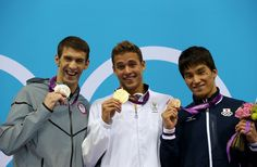 Silver medallist Michael Phelps of the United States, gold medallist Chad le Clos of South Africa and bronze medallist Takeshi Matsuda of Japan pose on the podium during the medal ceremony for the Men's 200m Butterfly final on Day 4 of the London 2012 Olympic Games at the Aquatics Centre on July 31, 2012 in London, England.