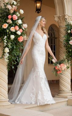 Taking traditional bridal beauty into the modern age, this stunner from Stella York is bringing classic back—literally. An elegant V-neckline starts off this ultra-feminine silhouette, complete with sheer lace straps and a beaded floating strap detail in the back for a totally modern twist. Sheath Wedding Gown, Lace Mermaid Wedding Dress, Gorgeous Wedding Dress, Dream Wedding Dresses, Designer Wedding Dresses, Wedding Gowns, Beautiful Dresses, Bridal Collection, Dress Collection