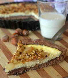 Crostata di ricotta e pere ricetta golosa buona e sfiziosa una crostata davvero invitante per la presenza delle pere e delle nocciole