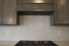18 - Kitchen Inspiration | Michael David Design Center | #interiordesign #subwaytile #herringbone #kitchen #backsplash #luxuryhome #dreamhome #custom