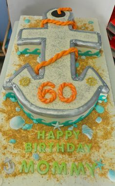 Nautical Anchor 60th Birthday Cake. Nearly a meter long Red Velvet Cake, covered with butter-cream and decorated with fondant.