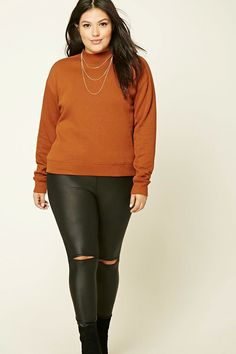 Forever 21+ - A fleece knit sweatshirt featuring a round neckline, long sleeves, and ribbed trim.