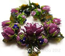 Jopanda lampwork beads - I can only imagine how long it took to learn to make these.... beautiful!
