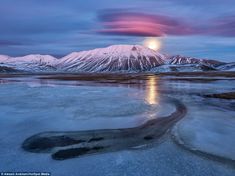 This picture, which Mr Andreani calls Pink Moonrise, shows the moon coming up behind Mount Redentore in Castelluccio di Norcia, Italy, giving the clouds a pink light