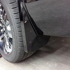 Tahoe Splash Guards, Rear Molded Set, Black:This Molded Rear Splash Guard set are fit directly behind the rear wheels to help protect against tire splash and mud. OEM Painted and have an embossed Chevrolet Bowtie Logo.