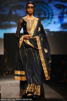 Black and gold lengha by Ritu Kumar