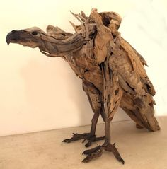 I want one in my garden!  Vulture by Tony Fredricksson  Love this drift wood scultpure! Amazing placement of natural resources