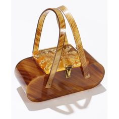 Vintage tortoise lucite box purse with amber carved floral top.