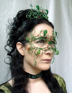 Gorgeous mask, make-up needs to be a little more smokey with complementary colors to the mask.