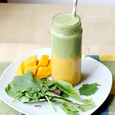 This layered smoothie has a sweet mango-banana base with an apple, greens, and tea smoothie on top.  It's a whole new world of flavor with two smoothies in one! recipes - www.homemadenutrition.com