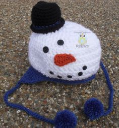 Cute Snowman Hat to wear during the winter and when playing in the snow.  Sizes available newborn to adult. The accent color in hat and the base of the snowman where the ear flaps and braids are can be chosen by the customer. Please note color choice when ordering. Choices are blue, yellow, green...
