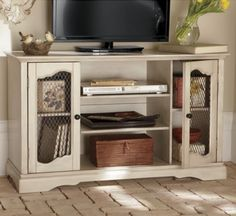 Side Mesh Door Entertainment Cabinet inspiration.
