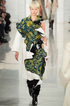7/23/16 I choose this picture because it shows a fascinating way of how color and textile texture is juxtaposed. Maison Margiela Spring 2016 Couture Fashion Show