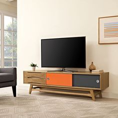 Concourse Stand, Natural - Engage your mid-century modern sensibilities with the Concourse Flat Screen TV Stand or Sideboard Cabinet. Meticulously crafted with two full-extension drawers and two panel sliding drawers painted orange and black, Concourse was designed to be a multipurpose addition to your living or dining room. Made of high grade MDF particleboard layered in smooth walnut wood veneer, and positioned on a splayed wood leg base with brushed stainless steel handles, Concourse is a…