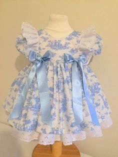 READY TO SHIP. Pretty girls dress in duck egg blue Toile de Jouy fabric. Size 12 - 18 mths French Toile de Jouy Dress Hand Made sizes by PartyPrincessDresses Baby Kids Clothes, Doll Clothes, Dress Clothes, Baby Girl Fashion, Kids Fashion, Little Girl Dresses, Girls Dresses, Baby Girl Party Dresses, Baby Dress Patterns