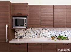 Caroline Beaupère designed a custom-made tile backsplash of delicate vines to bring a New York City kitchen to life.