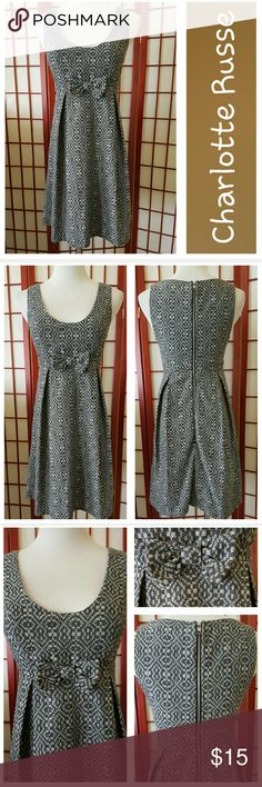 Charlotte Russe Dress! Super cute dress from Charlotte Russe.  Empire waist.  Pleats at waist to give fullness to the skirt.   Sleeveless.  Bow detail in front.  Zips in back.  Fully lined.  Sz S.  Measurements lying flat armpit to armpit 16in, empire waist 13in.  Great condition.   No stains or tears.  From smoke free home. Charlotte Russe Dresses
