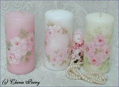 Hand painted candles by Cherie Perry. AJ HINT: Candles are easy to paint on as long as you only have a scant amount of water in the brush. I also sand very lightly on the area to be painted as there's often an oily (release film) residue from the candle mold. I don't recommend packing them in cellophane as on hot days the paint can stick to it. Tissue or paper towel is best to wrap them in before packaging.