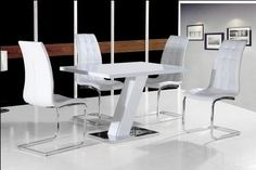 Impress your guests with this elegant and bold #diningset in high gloss white frame and polished steel base with 4 Enzo #Chairs.