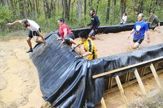 Participants make their way through a Zombie Run obstacle course