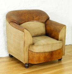 Stunning contemporary armchair The sensational and eye-catching Baudouin Retro Reverie Shabby Chic Salvaged Lumber chairs feature antiqued leather and cotton http://www.bonsoni.com/baudouin-retro-reverie-leather-tub-chair-single-sofa-shabby-chic-salvaged-lumber