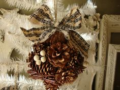 Christmas Pine cone ornaments with sheet music fabric ribbon large natural home decor ornaments cottage chic christmas decor. $8.50, via Etsy.