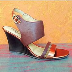 Awesome high heel gladiator sandals These snazzy sandals have shades of gold, bronze, and brown and a 4-inch wedge heel.  Sole is soft and flexible - quite comfortable.  Excellent, like-new condition -worn just a few times.  Size 8.5. Dexflex  Shoes Sandals