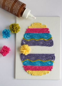 Pom Pom Easter Egg Yarn Art from Make and Takes