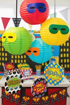 Like the idea of the masks on the balls hanging from ceiling.
