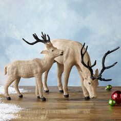 "TUNDRA BURLAP REINDEER -- Enjoy the peace and solitude of these quietly grazing burlap reindeer decorations on a mantel, table or in the entryway. Wire/coconut husk fiber/paper/string covered in burlap. Imported. Small, 13""W x 4""D x 13""H"