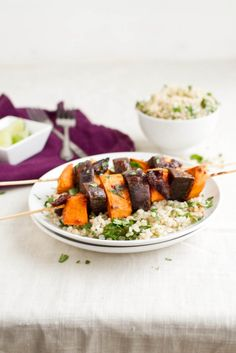 Chipotle Sweet Potato and Purple Potato Skewers served over cilantro lime brown rice.