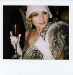 all the elements of style: gloves, hat, fur, champagne