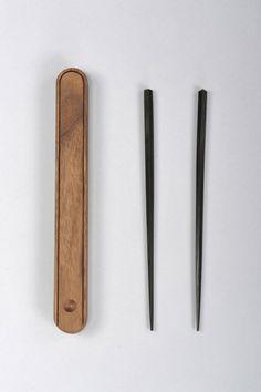 hashi no haco chopsticks.  But regular cheap chopsticks are TOTES fine.