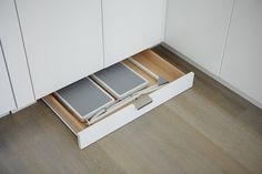 Pan storage under cabinets. Smart way to use wasted space in small kitchens