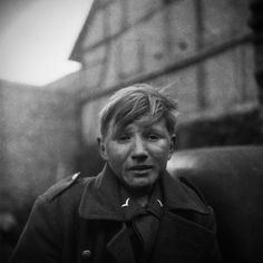 Boy Soldier :15-year-old German soldier crying when captured by allied forces, Normandy 1944.