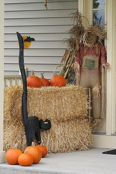 Since I live in an apartment, I don't have a front porch per se, but I'm going to do something this year with hay and pumpkins, either by my front door or fireplace.