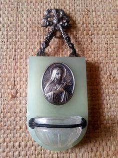 Antique Wall hanging French religious benitier stoup with brass and a medal of…