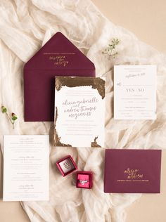 Maroon + gold foil invitations | Photography: Megan Noll