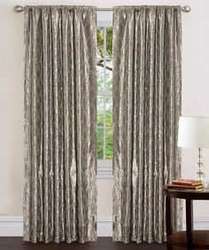 Add an element of elegance to the décor and adorn a window with this classic curtain. With an exquisite design of embroidery and sequins alongside luxurious taffeta, this stylish treatment featuresa convenient built-in pocket that easily slides onto a rod for quick installation.Includes one curtain panel and one tieback40'' W x 84'' H100% polyesterDry cleanImported