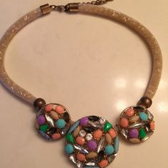 Stunning statement necklace with precious stones. Multi colored stones on gold cord necklace. Perfect for spring and summer.  Jewelry Necklaces