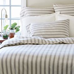 New Kennebunk Stripe Bedding by Taylor Linens features a duvet with matching Euro Shams and Pillow cases.