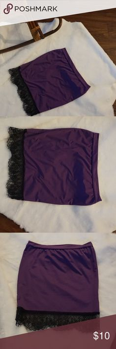 Purple skirt with lace trim Size L but fits more like a medium,  the lace is not stretch so gets a little tight around the legs.    A042 Skirts Midi