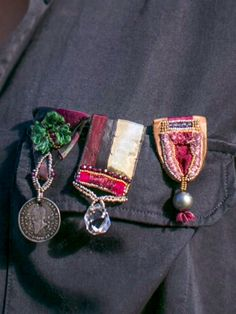 Old coin and vintage fabrics and trims used to create <medals>