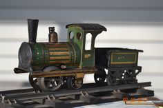 Issmayer Locomotive & tender German Tinplate (Clockwork Loco) Toy Trains, Model Trains, Rolling Stock, Tin Toys, Rubber Bands, Locomotive, Attic, Aunt, Crates