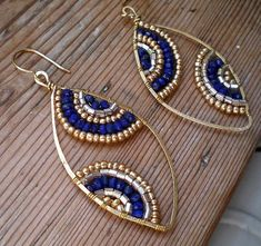 Lapis lazuli and brass pendant earrings. Handmade brass hoop Brass glass beads and Lapis lazuli roundelle beads. Pendant measures: 50 mm Brass tends to develop opaque patina due to the oxidation process which characterizes the beauty of this metal, giving it an aged look. My advice to