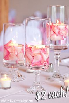 DIY wedding centerpieces with rose petals and candles. DIY wedding decor on a budget. Ideas and inspiration for wedding gifts, favours, venue decoration and keepsakes . Make Your Own and DIY projects would be great choices Summer Wedding Centerpieces, Wedding Vases, Simple Elegant Centerpieces, Christmas Centerpieces, Dollar Tree Centerpieces, Quinceanera Centerpieces, Diy Candles For Wedding, Centerpieces For Birthday Party, Cheap Wedding Shower Decorations