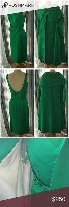 """MAD MEN emerald green dress with cape BREATHTAKING. Vintage1960s. Dress and cape are both lined. Cape is lined with white fabric. Green shell probably silk taffeta. Wonderful condition with 2 tiny (less than 1mm stain on the left bust and also left thigh). All measurements laying flat. LISTED AS SZ SMALL/SZ 4 but ** PLS REFER TO MEASUREMENTS** DRESS:  Bust: 16"""" to 16.5"""" inches - differentiates due to design. The two darts at bust are 7"""" across. Waist: 13"""" Length: 40"""" CAPE: Shoulder to…"""