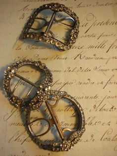 18th century shoe buckles. These could make a cute scarf tie.