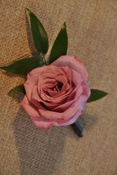 Wedding flowers - Vintage Style Boutonnière. A beautiful lavender rose with ruscus accent.  Coordinates with Vintage Style Bridal and Bridesmaid bouquets.